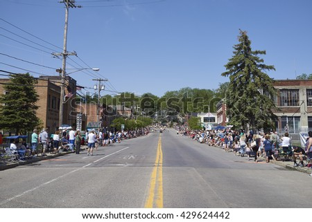 5/30/2016 Camillus Ny- People march down road in Memorial day parade.