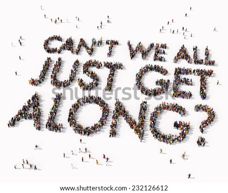 """Can't we all just get along"" text drawn out of people seen from above - stock photo"