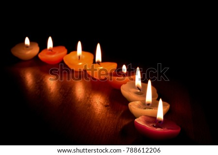 Candles placed in rows, select focus