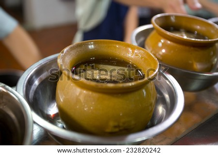 Cantonese soup in china package - stock photo