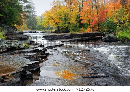 Canyon Falls, brilliant Autumn colors at the sturgeon river near Alberta, Michigan USA - stock photo