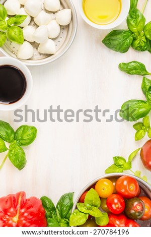 caprese salad ingredients on white wooden background, top view, place for text, italian food frame - stock photo