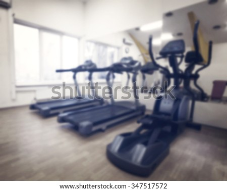 Cardio in gym against the window shot with blurred focus