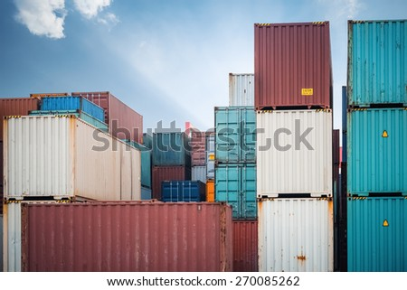 cargo containers against a dramatic sky, modern logistics background - stock photo