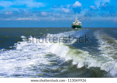 Cargo ship back to the harbor - stock photo