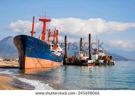 Cargo ship run aground on Anamur shore waiting for rescue - stock photo