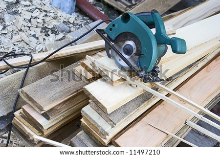 carpenters tool on the wood and shavings