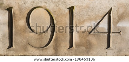 """""""1914"""" carved in stone at Tyne Cot War Cemetery, Flanders, Belgium.  Commemorating World War One  - stock photo"""
