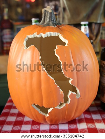Carved pumpkin at Italian restaurant in historic Little Italy in lower Manhattan.  - stock photo