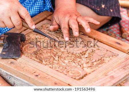 Carving wood - carpenter - stock photo