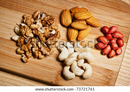 cashew nuts, walnuts, pistachios and almonds - stock photo
