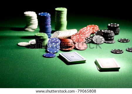 Casino gambling chips on green table - stock photo