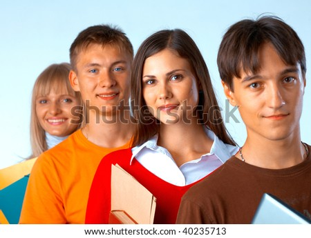 Casual group of college students smiling stand in a row with books on white - stock photo