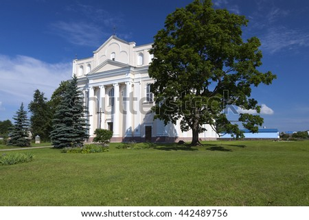 Catholic Church (built in 1785-1787 years), located in Ostrovec, Belarus (Church of Saints Cosmas and Damian) - stock photo
