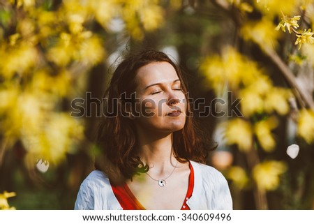 Caucasian girl relaxing and enjoying life in nature outdoors. - stock photo