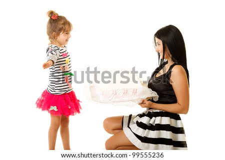 caucasian mother and her daughter on white background - stock photo