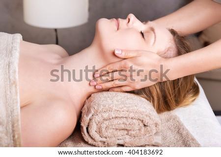 Caucasian woman having classic Face massage in Spa Salon - stock photo