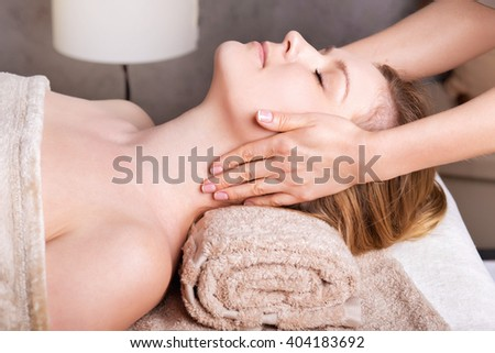 Caucasian woman having classic Face massage.Spa Salon rejuvenating Face  massage - stock photo