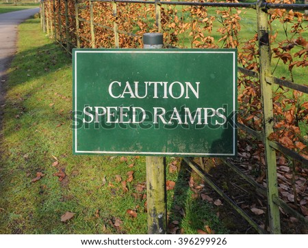 """""""Caution, Speed Ramps"""" Sign in the Arboretum near The Rural Village of Batsford near Moreton in Marsh within The Cotswolds, Gloucestershire, England, UK - stock photo"""