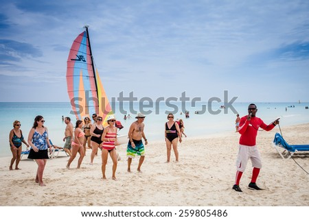 - Cayo Santa Maria, Cuba. February 18th 2015. Melia Las Dunas Hotel resort and view of the beautiful Beach and Canadian Tourists. Here is a Salsa Teacher and some students Dancing. - stock photo