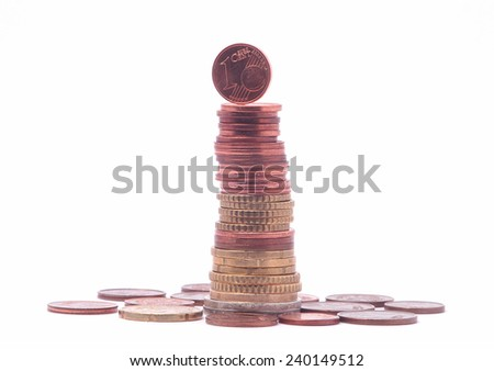 1 cent coin standing on top of stack of euro coins. Symbol for economy, business, income, banking, finance, leadership, progress - stock photo