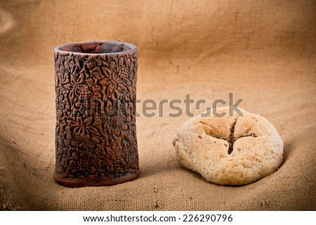 chalice and bread on the textile tablecloth
