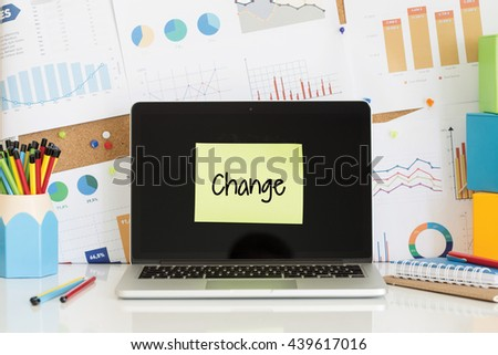 CHANGE sticky note pasted on the laptop screen - stock photo