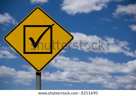 """Check box"" road sign against a blue sky background - stock photo"