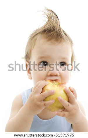 Cheerful baby eating apple