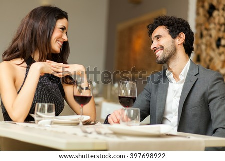 Cheerful couple in a restaurant - stock photo
