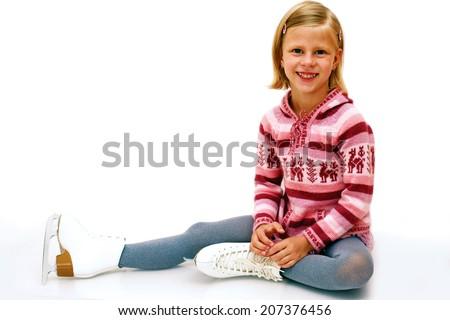 cheerful girl sitting on ice skates - stock photo