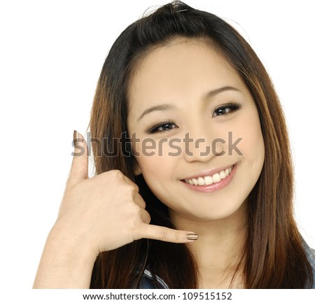 cheerful young lady gesturing a call me sign - stock photo