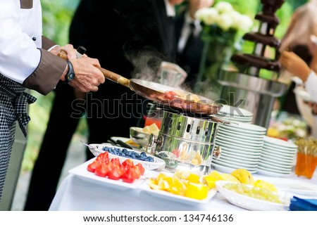 chef is cooking fruit - stock photo