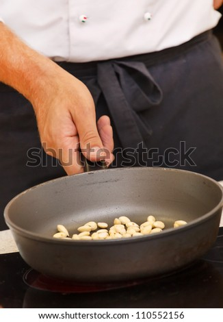 chef preparing almonds