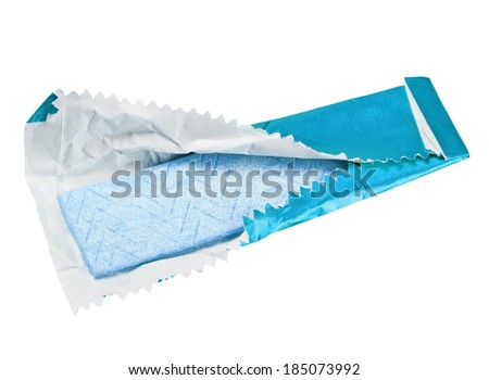 chewing gum is on the white background with paper  - stock photo