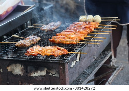 Chicken satay, delicious meat and fresh cook at the Asian market  - stock photo