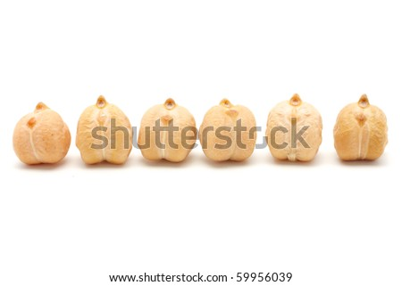 6 chickpea seeds are laid in a horizontal row. Isolated on white background.