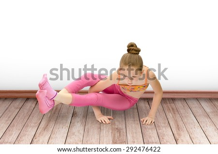 child the girl practices yoga - stock photo