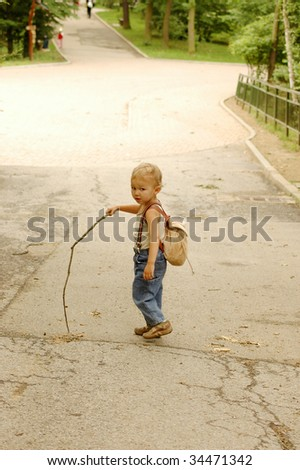 Child with a branch look back.