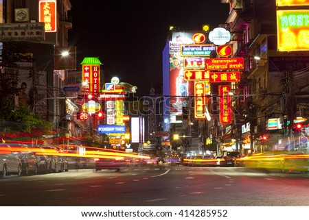 CHINATOWN, BANGKOK, THAILAND - CIRCA MAY, 2016: Cars and shops on Yaowarat road, the main street of China town.