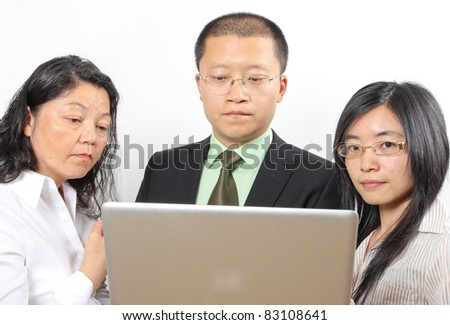 3 chinese businesspeople - stock photo