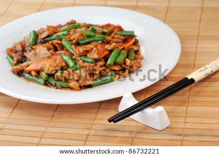 chinese cuisine. deep fried chicken with red sauce and beans