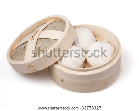 chinese dumpling in a bamboo steamer - stock photo
