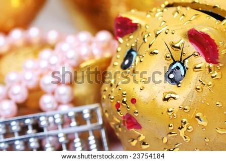 chinese gold ingots and jewelry,piggy - stock photo