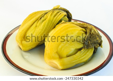 Chinese green mustard preserved on plate - stock photo