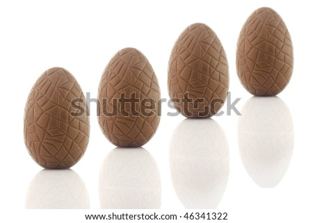 Chocolate eggs isolated on a white background - stock photo