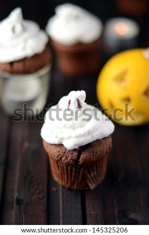 Chocolate pumpkin cupcake - stock photo