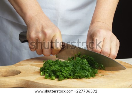Chopping green dill - stock photo