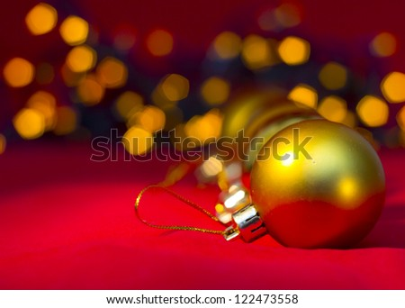 2013 Christmas  and New Year Decoration. Gold  baubles reflected on the red background