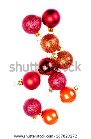 Christmas baubles  isolated on white backhroun��². Festive glittering red balls close up with copy space for greeting text. - stock photo